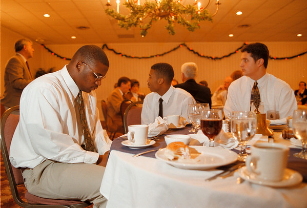 98/12/01 Tip-Off Luncheon - Vino Wong Photo - Lockport High basketball players Curt Snowden, Shawn Maxwell and Casey Mullett listen as their coach speaks to the Lockport Rotary Club members during a luncheon at the Best Western Tuesday.