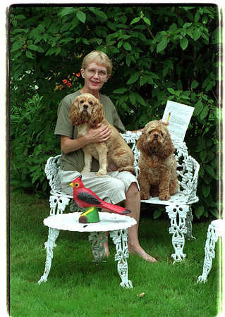 7/28/97 S. Summerfield - James Neiss Photo - Shirley Summerfield and dogs Rosie (lap) and Heather in her back yard garden.