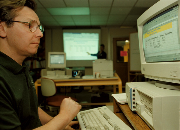 98/11/02--KEENEN BOCES COMPUTER--DAN CAPPELLAZZO PHOTO--PAUL REEVES, OF NT COMPLETES AN ACTION DURING A BOCES COMPUTER CLASS AS INSTRUCTOR SUE SAVARD GOES OVER MATERIAL AT THE KEENEN CENTER.<br /> <br /> SUNDAY