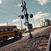 97/09/24--R&R CROSSING--DAN CAPPELLAZZO PHOTO--A SCHOOL BUS CROSSES A R&R TRACK ON RT31 NEAR SHAWNEE OF IN THE TOWN OF SANBORN.<br /> <br />  LOCAL