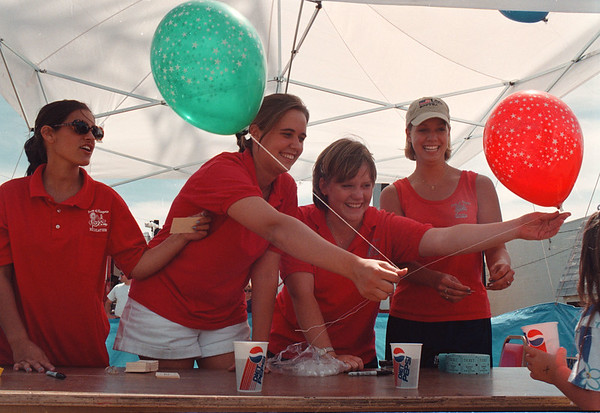 97/08/14-- summer picnic2--Takaaki Iwabu photo-- Staff at Town of Niagara Recreation Dept. give away baloons to visitors to Summer Picnic & Carnival. From left, Jen Wrobel, Michelle Milleville, Ann Fitzpatrick and Jillian Harris. <br /> <br /> tmc photo
