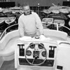 1/8/97--BOAT SHOW--CAPPY PHOTO--BOB COPELIN, CO-OWNER OF COLLINS MARINA, TONAWANDA, BUFFS UP A 35FT CABIN CRUISER, RETAIL VALUE $160,000, AT THE NFCC.