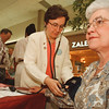 4/12/97-- health fair-- Takaaki Iwabu photo-- Madalene Ansel R.N. of Niagara County Health Dept. checks Joan Sirianni's blood pressure at Health Fair in Summit Park Mall Saturday.