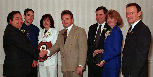 98/05/06 Small Business Awards *Dennis Stierer Photo - Left to Right: Rod Cague, son Tom, and wife Jackie of Niagara Computer Center, C of C small business of the year;  Rhodes Palmer, president of Chamber of Commerce; Tod and Jean Canty of J.M.Canty Co., SBDC's APEX award winner and Richard F. Gorko, Director of Small Business Dev. Center with NCCC.