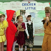 98/03/04 Four Stories *Dennis Stierer photo - Mrs. Apolito's third grade class from Charles Upson School acted out four stories for PARP month for fellow students and parents. The students revised their own version of the stories, created the scenery and costumes. The four stories were:  Chicken Little;   Little Red Riding Hood;  The Wizard of Oz;   and Hansel & Gretel.  Going over some of their routine are Cassandra Vacanti;  Korey Dekker;  Lindsay Lovitz;  Andrea Colton;  and Cchase Finnan.