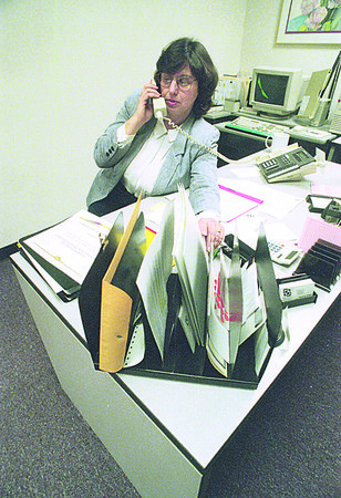 1/3/97 Working Poor - James Neiss Photo - Theresa M. DeMarco, a program Support Specialist at Everywoman Opportunity Center, Inc. Works more than one job to make ends meat. (didn't want name of business used... Check Mike K's Story)
