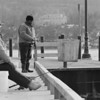 3/10/97--YE OL' FISHIN' HOLE--DAN CAPPELLAZZO PHOTO--(FRONT TO BACK) LARNELL BRIGGS AND REV. WILLIAM E. FEAGIN, BOTH OF NF FISH FOR PEARCH OFF THE LEWISTON DOCKS. ALTHOUGH WINDS WERE BRISK TO SUN PROVIDED SOME WARMTH ON THE LOWER NIAGARA MONDAY AFTERNOON.<br /> <br /> GR