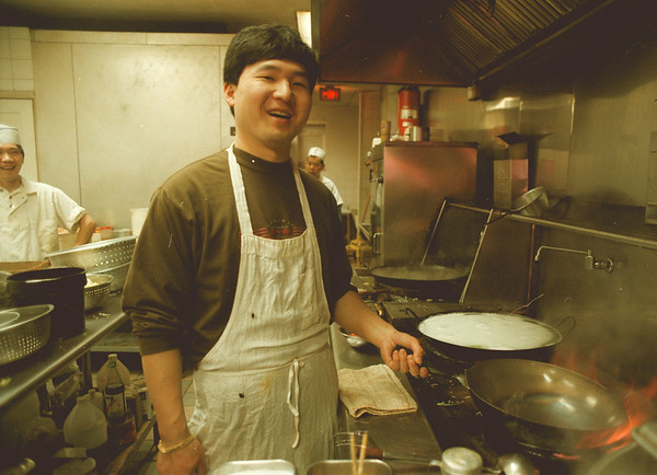 98/02/03-- china town --Takaaki Iwabu photo-- Hak Man Wong, owner of Chinatown, works in the kitchen. His 5-year-old restaurant on Pine Avenue serves Chinese food to the locals everyday.<br /> <br /> grapevine photo