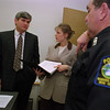 3/12/97--DOMESTIC VIOLANCE/NF POLICE--DAN CAPPELLAZZO PHOTO--(LTOR)ASSISTANT D.A.  MOISES JULIAO AND ERICKA PHILLIPS, DEPUTY COOR. NIAGARA CO. DOMESTIC VIOLANCE INTERVENTION PROGRAM, SPEAK WITH NF POLICE PATROLMAN ALFONSO CIRRITO ABOUT AN ONGOING CASE.<br /> <br /> 1A FOLDER