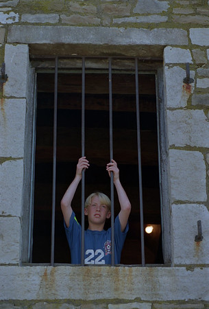 97/08/04--CHILD PRISONER/FT NIAGARA--DAN CAPPELLAZZO PHOTO--11-YR-OLD BRANDON LANGILL, OF EDINBORO, PA, LOOKS OUT A TOP FLOOR WINDOW OF THE FRENCH CASTLE AT FT. NIAGARA.<br /> <br /> GRAPEVINE