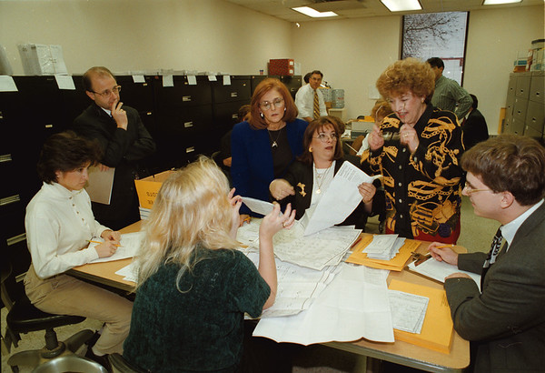 98/11/10 Vote Counting - James Neiss Photo - Clockwise from Blond with back to us, Tracie Bolton - election clerk, Francine DelMonte - observer, John DelMonte - observer, Judith Cirifalco - Democratic Commissioner, Pattie Page - Election Clerk, Lucille Britt - Republican Election Commissioner and Mike Norris, Republican Commissioner-Elect. They were all counting the Absentee Ballots.