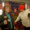 97/11/14 Salvation Army - James Neiss Photo - Bell Ringer Abbe Gillingham let's people entering Tops International on NF BLVD in NF know that its now the giving season. Debra Battaglia of 4th St. NF donates to the needy.