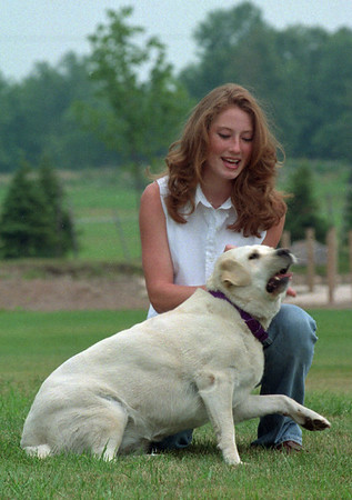 98/08/05--JR NYS/LEWIS--DAN CAPPELLAZZO PHOTO--JR MISS NYS CHRISTEN LEWIS ROMPS WITH HER 8-YR-OLD LAB BAILEY. LEWIS IS PLANNING TO ATTEND COLGATE COLLEGE FOR VET STUDIES.