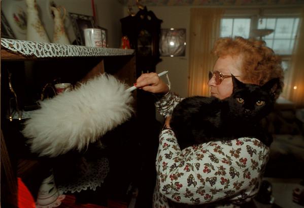 97/12/03 Baby Boy - James Neiss Photo - Irene Bouley of Lockport loves her cat Baby Boy. Judy K. Story.