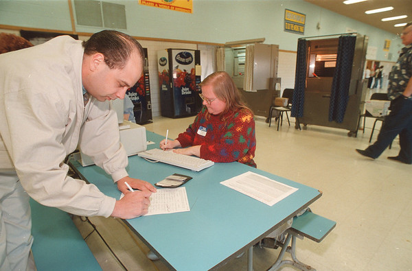 5//20/97 Wheatfield Vote - James Neiss Photo - Michael Alberecht of Wheatfield, 278-4750 Or 731-8148, registers to vote with help from volunteer Becky Ashby., 297-4363 aft 8 pm.
