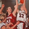 3/1/97-- Falcons 1--Takaaki Iwabu photo-- NW HS Jennifer Grawe looks for the basket against Orchard Park's Whitney Meno.