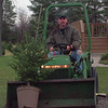 98/12/07 booth trees--danc appellazzo photo--don booth transfers a 6-yr-old  fraiser fur at his barker farm