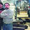 98/1/16 Sharpe Ind-Rachel Naber Photo-Frank Maser, Vice president(left) and Bob Sharpe, President (right) of R. Sharpe Industries in Wilson is having trouble starting his small business because of the taxes.