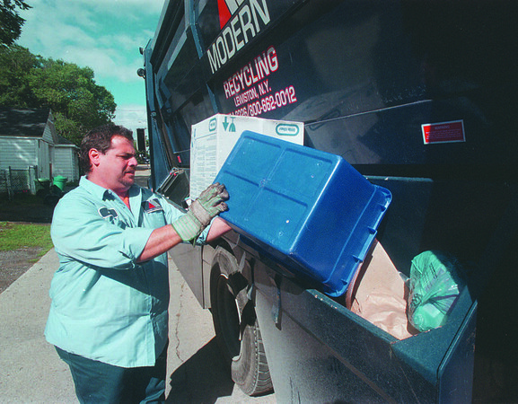 97/09/03 Recycling - James Neiss Photo - Jeff LiCastro, a former city worker now working for Modern, separates recyclables on his rout in the Deveaux area.