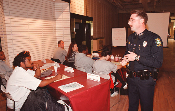5/13/97--CITIZANS POLICE ACADEMY--DAN CAPPELLAZZO PHOTO--NF POLICE OFFICER DANIEL JONES SPEAKS TO AREA RESIDENTS ABOUT HOW TO ID A CRIMINAL AT THE SUMMIT MALL NF POLICE SHOW.<br /> <br /> LOCAL NEWS