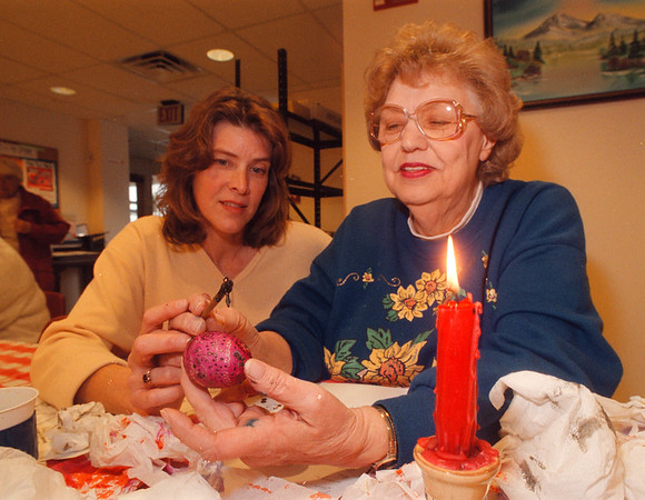 3/14/97 Egg Decoration - James Neiss Photo - Ruth Hrywnak, Pysank Instructor, helps Marge Burnett of Lewiston whith her Pysank technique, wich is the Ukranian method of dying easter eggs, at the Lewiston senior centers craft class.