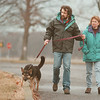 "98/03/01--weather --Takaaki Iwabu photo--It was a bit rainy, but Paul and Amy Incorvaia of Youngstown still found warm weahter Sunday and took a walk with their 9-month dog ""Elmo"" at Fort Niagara State Park. <br /> <br /> Monday, color, 1A"