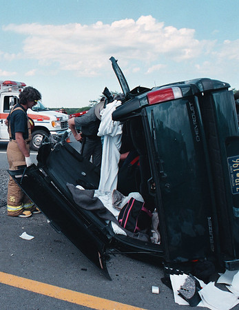 7/28/97--MVA/190--DAN CAPPELLAZZO PHOTO--STATE TROOPERS AND MEMBERS OF NIAGARA ACTIVE HOSE CO. LOOK OVER A FLIPPED BLAZER AFTER CUTTING THE ROOF OFF THE VEHICLE TO FREE THE 4 ADULT PASSENGERS. THE TWO CAR ACCIDENT OCCURED ON THE 190 SOUTH BOUND NEAR EXIT 24 (WITMER RD.) AT ABOUT 4 P.M.<br /> <br /> LOCAL