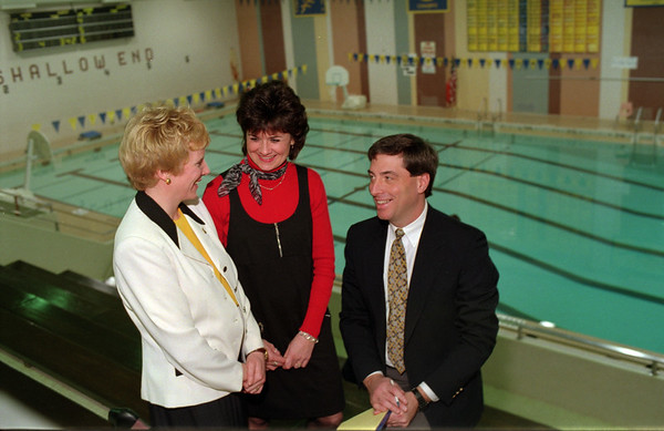 98/01/08 Senior Swim Program*Dennis Stierer photo - Discussing the new swim program at the Lockport Senior High School pool are from L-R:  Mary Glen, Development Director for the Dale Association; Michelle Bradley, Coordinator of Ciriculum and Staff Development for the Lockport City School District and Patrick Burke, Director of Physical Education and Athletics for the Lockport City School District.