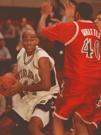 98/02/02 NU basket 2-- Takaaki Iwabu photo-- Kevin Jobity of Purple Eagles keeps a ball under the basket against Marist's Bryan Whittle. <br /> <br /> b&w