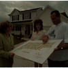 98/06/03 Home Sales - James Neiss Photo - L-R - Peggy Wills Sales associate with Hunt Realestate, Jennifer Caldwell Wheatfield  Dpt. of Building Inspections and Brian Ellsworth, President of Churchill Builders, all look over a map of the subdivision.