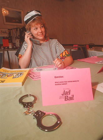 97/09/10 Jail and Bail - James Neiss Photo - Jail and Bail at the Radisson Hotel Carol Gee-Augstell a NF School Board Member does her civil duty and calls around to friends and relatives to raise money for the March of Dimes.
