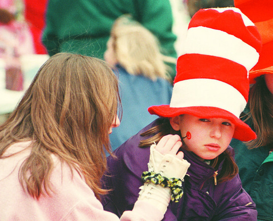 4/20/97--LEWISTON SPRING FLING--DAN CAPPELLAZZO PHOTO--14-YR-OLD FACE PAINTER MONICA FOOTE, OF YOUNGSTOWN, PAINTS THE FACE OF 9YR-OLD ALLISON SWAVY OF LEWISTON AT THE ANNUAL SPRING FLING AT MARILYN TOOHEY PARK, LEWISTON.<br /> <br /> ECHO