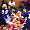 98/12/03 Medina Girls Opener *Dennis Stierer Photo<br /> Medina's #20 gets caught in heavy traffic from Hamburgs, #44 and #14.