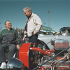 98/10/04 Treichler Benefit *Dennis Stierer Photo -<br /> The people came out from far and near for a car show and dance benefit that was held at the Pendleton House in Lockport for Roger Treichler, in wheelchair, an ex-stock car driver who is now paralyzed after a fall from his roof. His old high school auto mechanics teacher, Gilbert Kroening (right) of Niagara Wheatfield  was there to lend support for an old student.