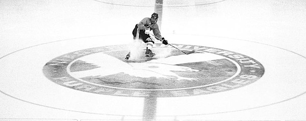 10/22/96--N.U. HOCKEY ACTION--CAPPY PHOTO--N.U. FORWARD RICH DeCAPRIO STOPS AT CENTER ICE/THE PURPLE EAGLES LOGO DURING A RECENT PRACTICE.<br /> <br /> THURS SP