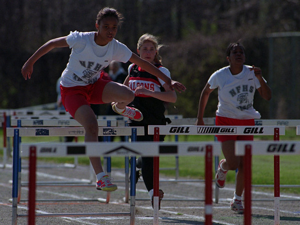 5/15/97-- track meet 1 --Takaaki Iwabu photo-- Le'Nee Threats, 8th-grader of Niagara Falls HS won the girl's 100m hurdles during the track meet against Niagara-Wheatfield HS Thursday. <br /> <br /> sports, Friday