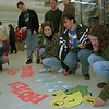 "98/02/27--tops art --Takaaki Iwabu photo-- Newfane High School students get ready to put their art works inside the Tops (at Wright's Corners) Friday. As part of ""School To Work"" program, students from art and marketing class display their work at the store on Lockport-Olcott Read.      -- photo bin, color"