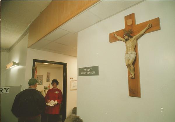 98/02/02 Hospital Religion 2 - James Neiss Photo - Patty Clark, Patient Registration Rep. talks to a patient.