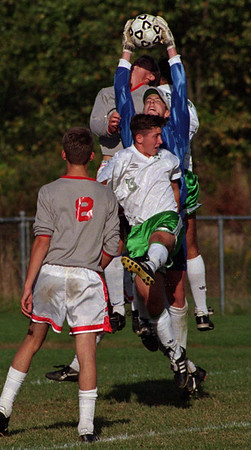 97/09/24 NT at LewPort - James Neiss Photo - LewPorts #13 Collyn Pankratz goes up aginst NT's Golie in the first half.