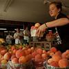 98/08/04-- farm market --Takaaki Iwabu photo-- Julie Klejdys, employee at GoodmanÕs Farm Market on Niagara Falls Blvd., stocks the shelves with fresh peaches Tuesday. --for HaleÕs story on dely on farm market at Summit Park Mall...<br /> <br /> local, bw, Wednesday
