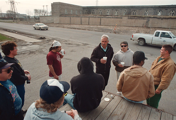 "4/23/97-- old waterplant-- Takaaki Iwabu photo-- Workers wait in front of the old water plant on Buffalo Ave. (City and Sansla, the company which has the contract, keep workers wait outside of the plant all morning while they ""sort out the paper works."")     1A, Thursday"