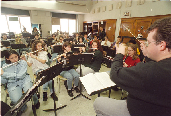 3/20/97 NF Band - James Neiss Photo - Paul Wos, Band Director, Practices with band members who are going to Florida. <br /> <br /> Teen Page<br /> Niagara Falls High School NFHS
