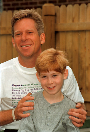 98/10/03 luekemia Marathon-Rachel naber Photo-John Rogers and his favorite running partner, Nathan his son, 8 years old. Rogers will be running a marthon for Luekemia  in Dublin Ireland on October 26 after raising 38,000 dollars in sponsorship fund s from abpout 100 private sources.