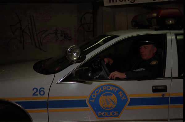 98/1/31 Park Prob-Rachel Naber Photo- Officer Roger Barone of the Lockport police department understands the problems at the downtown parking garage having seen grafitti and other damage on his patrols.