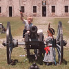 6/15/97 Family Fun Day - James Neiss Photo - It was Family Fun Day at Old Fort Niagara. L-R:  Here, Ray Ball 6yrs of West Seneca, announces the charge as Willi Emerson, 5yrs of Youngstown, stands ready for action (Black Hat and dress, boys wore dresses way back when), the two boys were having fun playing on and around the old fort cannon.