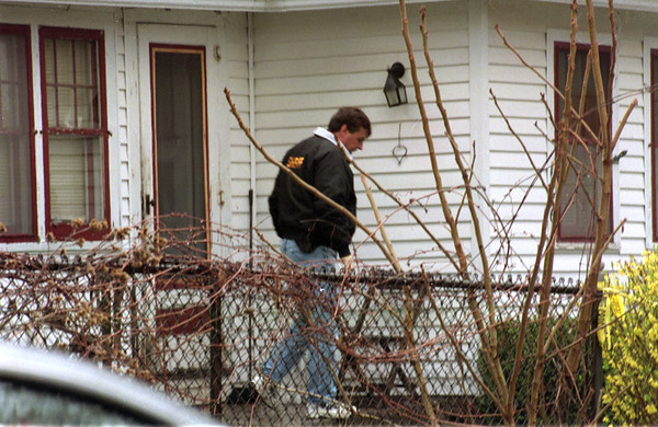 98/04/16 Homicide?-Rachel Naber Photo- Police officers exit the house at 1576 Jackson street in Olcott where an alleged murder took place Thursday.