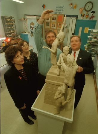 98/03/16 Gaskill Sculpture - James Neiss Photo - L-R - Gaskille Art Teacher Ruby Catherine, Sandra Olsen, Dir. of the Castellani Art Museum, Dave Poulin, Sculptor and Mayor James Galie. Sculptor to work with students in creating work for former statue of liberty podium in Hyde Park.