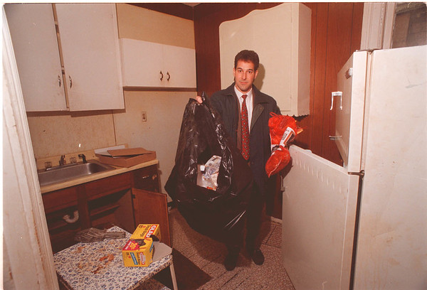 2/5/97 Michael A. Nappo - James Neiss Photo - Michael A. Nappo, Real Estate Broker, starts the cleanup process at a home vacated by a Social Services Client in the middle of the night who owed 2 mos. rent and left the house dirty at 508 Ceder Ave..