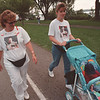 9/14/97--AIDS WALK 2--DAN CAPPELLAZZO PHOTO--SANDY STACHOWSKI WALKS WITH HER DAUGHTER AMY ZBIESZKOWSKI, AND AMY'S 6 MONTH OLD SON MASON CANCILLA DURING THE GOAT ISLAND AIDS WALK. THE TWO ARE WEARING SHIRTS WITH A PICTURE OF SANDY'S BROTHER AND AMY'S FATHER WHO DIED OF AIDS 4 YRS AGO.<br /> <br /> LOCAL