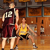 98/12/05 LHS vs Orchard1- Rachel naber Photo-Brian Dux (#12/left) of Orchard park goes up against Marques Palmer(#12/right) of Lasalle in the Niagara PAL tip iff tournament.